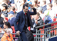 Football - 2018 / 2019 Premier League - Tottenham Hotspur vs. Arsenal<br /> <br /> Unai Emery, manager of Arsenal FC, throws his arms up in frustration at Wembley Stadium.<br /> <br /> COLORSPORT/DANIEL BEARHAM