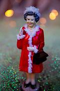 Statuette of Queen Elizabeth II, in a shop window in London, UK.