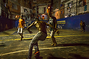 Young boys play a game of football in the heart of favela Tavares Bastos, Rio de Janeiro.