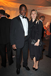 French rugby international SERGE BETSEN and his wife FREDERIQUE at a gala evening in aid of Ubuntu Education Fund held at Battersea Power Station, London on 4th May 2011.