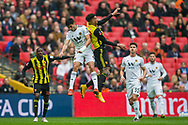 Raul Jimenez (Wolverhampton Wanderers) & Etienne Capoue (Watford) heading the ball during the FA Cup semi-final match between Watford and Wolverhampton Wanderers at Wembley Stadium in London, England on 7 April 2019.