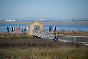 Families take in the view of the Bay Area during Santa Clara County Park's Day on the Bay event at Don Edwards San Francisco Bay National Wildlife Refuge in Alviso, California, on October 9, 2016. (Stan Olszewski/SOSKIphoto)