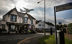 "© Licensed to London News Pictures. 27/10/2016. London, UK. A Singapore Airlines Airbus A380 takes off from Heathrow airport over the village of Longford. The government has announced that a third runway will be built at the United Kingdom's busiest airport. The Cabinet are divided - with Foreign Secretary Boris Johnson saying that the project is ""undeliverable"". Conservative MP for Richmond Zac Goldsmith has resigned. Photo credit: Peter Macdiarmid/LNP"