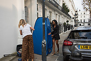 Instagrammers @reinarougestyle a ( blonde ) nd @jamilaamunroe posing for each other in Chelsea.  London. 30 March 2019