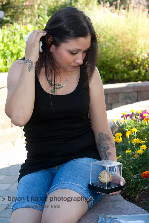 Cheri Le joined the Mothers of an Angel Friendship Network after her six year old daughter died. I photographed Cheri in Martha Tessmer's backyard with a rose Cheri's daughter gave Cheri. Martha started Mothers of an Angel Network after her son Donovan died.