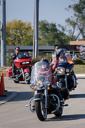 10 OCTOBER 2020 - DES MOINES, IOWA: US Senator JONI ERNST waves from her motorcycle while she arrives at a campaign event. Sen. Ernst is on a ride across Iowa. She left Sioux City Saturday morning and stopped in Carroll, IA, before ending the day's ride in Des Moines at Big Barn Harley-Davidson. She had a rally in the parking lot of the Harley-Davidson dealership. The ride is a fundraiser for the Puppy Jake Foundation (which provides service animals to veterans) and the Greater Cedar Rapids Community Foundation's Derecho Disaster Recovery. About 50 people rode with Sen Ernst from Carroll to Des Moines and another 80 were waiting for her in Des Moines.     PHOTO BY JACK KURTZ