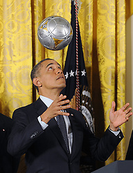U.S. President Barack Obama juggles with a soccer ball as he welcome the Stanley Cup champion Los Angeles Kings and the Major League Soccer champion LA Galaxy to the White House to honor their 2012 championship seasons in a ceremony in the East Room of the White House March 26, 2013 in Washington, DC. Photo by Olivier Douliery/ABACAPRESS.COM  | 358315_003 Washington Etats-Unis United States