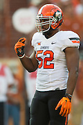 AUSTIN, TX - SEPTEMBER 26:  Ryan Simmons #52 of the Oklahoma State Cowboys looks on against the Texas Longhorns on September 26, 2015 at Darrell K Royal-Texas Memorial Stadium in Austin, Texas.  (Photo by Cooper Neill/Getty Images) *** Local Caption *** Ryan Simmons