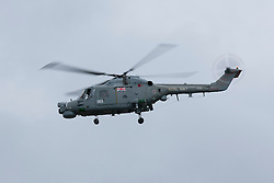 © Licensed to London News Pictures. 04/05/2012. LONDON, UK. A Royal Navy Sea Lynx is seen after it took off from the deck of HMS Ocean, the Royal Navy's helicopter carrier, after the ship docked in Greenwich, London, today (04/05/12). HMS Ocean has been deployed as part of an exercise involving the RAF, British Army and Royal Navy taking place across London as part of security preparations for the 2012 London Olympic Games. Photo credit: Matt Cetti-Roberts/LNP