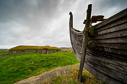 Viking longhouses and reconstructed Viking longboat at Haroldswick, Unst, Shetland, Scotland, UK