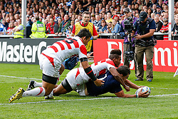 Scotland Flanker John Hardie scores a try as Japan Winger Kotaro Matsushima attempts a tackle - Mandatory byline: Rogan Thomson/JMP - 07966 386802 - 23/09/2015 - RUGBY UNION - Kingsholm Stadium - Gloucester, England - Scotland v Japan - Rugby World Cup 2015 Pool B.