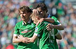 03.05.2014, Weserstadion, Bremen, GER, 1. FBL, SV Werder Bremen vs Hertha BSC, 33. Runde, im Bild Aaron Hunt (Bremen #14) laesst sich nach seinem zweiten Treffer von Clemens Fritz (SV Werder Bremen #8) und Santiago Garcia (SV Werder Bremen #2) feiern // Aaron Hunt (Bremen #14) laesst sich nach seinem zweiten Treffer von Clemens Fritz (SV Werder Bremen #8) und Santiago Garcia (SV Werder Bremen #2) feiern during the German Bundesliga 33th round match between SV Werder Bremen and Hertha BSC at the Weserstadion in Bremen, Germany on 2014/05/03. EXPA Pictures © 2014, PhotoCredit: EXPA/ Andreas Gumz<br /> <br /> *****ATTENTION - OUT of GER*****