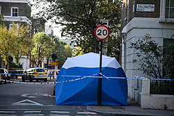 © Licensed to London News Pictures. 12/05/2019. London, UK. A police tent at the scene near Waitrose in Islington, North London, where a body was found in a wheelie bin on Saturday afternoon. The discovery was made just a few hundred meters from the home of Labour Party leader Jeremy Corbyn. Detectives are now trying to identify the man. Photo credit: Ben Cawthra/LNP