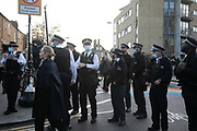 Police wearing face masks get ready to break up people gathered by the Regents Canal and in Broadway Market during the second coronavirus national lockdown on November 7th 2020 Hackney, East London, United Kingdom. Too many people, according to social distance rules gathered in and around Broadway Market on and police had to  ask people to move on to respect the lockdown restrictions of social distancing. The UK Government introduced a 4 week lockdown from November 5th - December 2nd to combat the coronavirus outbreak. It is the third day of the national lockdown and restrictions mean that people are only allowed to meet outside, in pairs and only if keeping social distance. Only if they already live together or have formed a social bubble can they interact freely.
