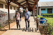 VSO volunteers Dr Siobhan Neville and Dr Peter O'Reilly walk through one of the hospital corridor of St Walburg's Hospital, Nyangao. Lindi Region, Tanzania.