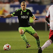 Osvaldo Alonso, Seattle Sounders, in action during the New York Red Bulls Vs Seattle Sounders, Major League Soccer regular season match at Red Bull Arena, Harrison, New Jersey. USA. 20th September 2014. Photo Tim Clayton