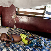 November 20th 2013, at the MSF clinic of Bossangoa, a young boy suffers from Malaria and malnutrition. <br /> <br /> Over 40 000 IDPs have fled their village in the region of Bossangoa and taken refuge in the Bichopstery of the town because of the violence carried out by the Seleka.  There very little humanitarian is available on the ground, and poor sanitary conditions put people at risk of malaria, malnutrition and chest infection.