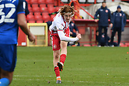 Stevenage midfielder Arthur Read (19)  shoots at goal misses the target during the EFL Sky Bet League 2 match between Stevenage and Carlisle United at the Lamex Stadium, Stevenage, England on 20 March 2021.