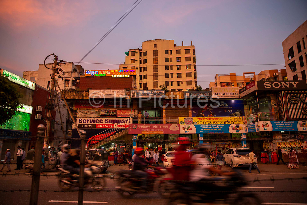 Sunset along a bustling Kazi Nazrul Islam Avenue in Tejgaon district on the 23rd of September 2018 in Dhaka, Bangladesh.