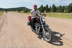 Sean Lichter on his first ride to Sturgis on his Sportster during the 75th Annual Sturgis Black Hills Motorcycle Rally.  SD, USA.  August 3, 2015.  Photography ©2015 Michael Lichter.