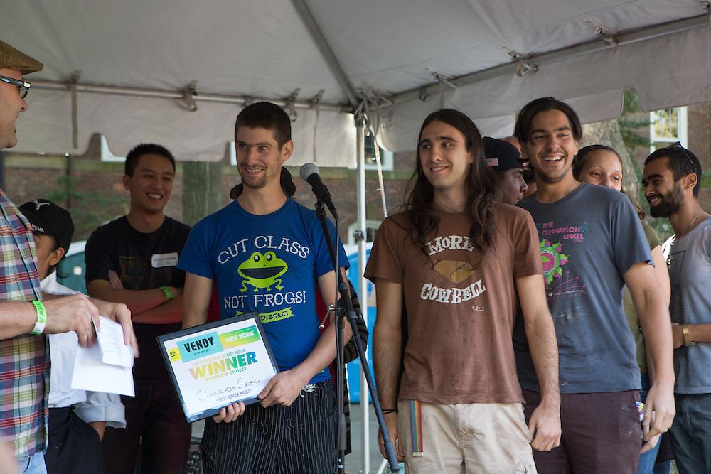 Adam Sobel, of the Cinnamon Snail, an organic vegan food truck, accepts the People's Choice award.