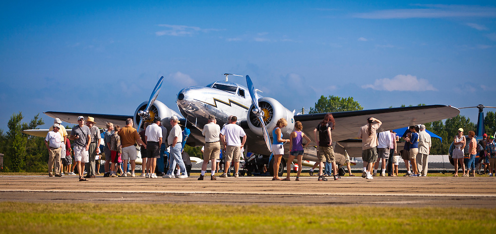 Joe Shepher's Lockheed 12A Electra Junior draws a crowd at the annual Cracker Fly-in in Gainesville, Ga.