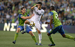 September 27, 2017 - Seattle, WASHINGTON, U.S - Whitecaps midfielder CHRISTIAN BOLANOS (7) works against the Sounders defender GUSTAV SVENSSON (4) as the Vancouver Whitecaps visit the Seattle Sounders for an MLS match at Century Link Field in Seattle, WA. (Credit Image: © Jeff Halstead via ZUMA Wire)