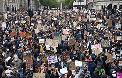 © Licensed to London News Pictures. 06/06/2020. London, UK. Protesters gather in Parliament Square, central London during a Black Lives Matter demonstration over the killing of African American George Floyd. The death of George Floyd, who died after being restrained by a police officer In Minneapolis, Minnesota, caused widespread rioting and looting across the USA. Photo credit: Peter Macdiarmid/LNP