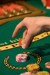 Blackjack player in Las Vegas, Nevada, Caesars Palace and Casino, gaming, gambling,  hand, chips, betting, model released, NV, Las Vegas, Photo nv227-17432.Copyright: Lee Foster, www.fostertravel.com, 510-549-2202,lee@fostertravel.com