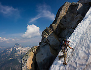 Jim Prager climbs steep snow below the summit of Mount Challenger, Picket Range, North Cascades National Park, Washington.