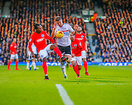 Matt Smith of Fulham and Gaetan Bong  of Brighton and Hove Albion during the Sky Bet Championship match at Craven Cottage, London<br /> Picture by Richard Brooks/Focus Images Ltd 07947656233<br /> 02/01/2017