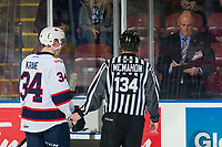KELOWNA, CANADA - NOVEMBER 21: Linesman Dave McMahon directs Riley Krane #34 of the Regina Pats to the penalty box against the Kelowna Rockets on November 21, 2018 at Prospera Place in Kelowna, British Columbia, Canada.  (Photo by Marissa Baecker/Shoot the Breeze)