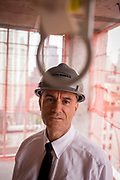 Investigative Engineering Services, Assistant Commissioner Tim Lynch inspecting a new construction site in Manhattan, New York City. Tim works in the prevention of damage to old and ensuring new buildings are up to standard plus often, assessing the status of a collapsed structure. From the chapter entitled 'The Skyline' and from the book 'Risk Wise: Nine Everyday Adventures' by Polly Morland (Allianz, The School of Life, Profile Books, 2015).