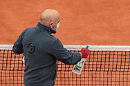 Gardner assistant of net cleaned the net on Suzanne Lenglen stadium during the Roland Garros 2020, Grand Slam tennis tournament, on October 5, 2020 at Roland Garros stadium in Paris, France - Photo Stephane Allaman / ProSportsImages / DPPI