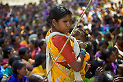 A tribal woman and her baby at a gathering to protest and listen to speeches at Bijepur during a rally organised by the Adim Adhikar Surakshya Manch (a group to protect tribal groups) against the Vedanta plant. Orissa, India. The Dongria Kondh are a protected 'Scheduled' Caste of Original (aboriginal) people that practice animism and live a settled rural life. Their deity is a mountain from which a mining company, Vedanta is seeking to extract bauxite which will largely destroy the mountain and the Kondh's traditional way of life.
