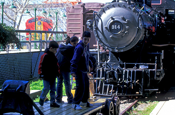 Group of young children standing on a flat rail car in Galveston Texas