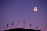 Moon over wind turbine clean energy windmills, Altamont Pass, Alameda County, California