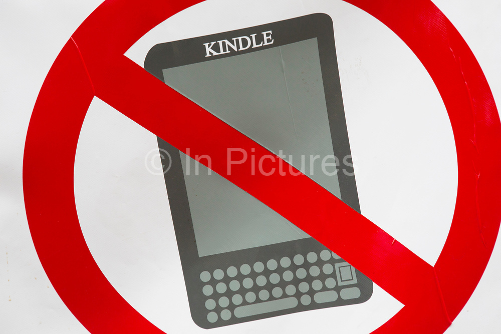 """Signs promotong a ban on Kindles at Hay-on-Wye or Y Gelli Gandryll in Welsh, known as """"the town of books"""", is a small town in Powys, Wales famous for it's many second hand and specialist bookshops, although the number has declined sharply in recent years, many becoming general antique shops and similar."""