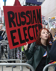 May 4, 2017 - New York, New York, U.S. - An anti Trump protester waits outside the Intrepid Air & Space Museum marking Trump's first visit to NYC since he became President. (Credit Image: © Nancy Kaszerman via ZUMA Wire)