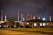 Christmas lights on homes near the The Valero Meraux Refinery, in Meraux, Louisiana.