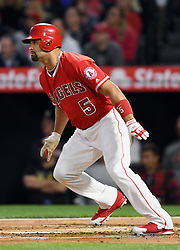 April 18, 2018 - Anaheim, CA, U.S. - ANAHEIM, CA - APRIL 18: Los Angeles Angels of Anaheim designated hitter Albert Pujols (5) hits a single for his 2990th career hit in the first inning of a game against the Boston Red Sox played on April 18, 2018 at Angel Stadium of Anaheim in Anaheim, CA. (Photo by John Cordes/Icon Sportswire) (Credit Image: © John Cordes/Icon SMI via ZUMA Press)