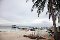 Caye Caulker's coastline has many small docks to service the many diving, snorkelling and fishing boats.