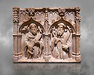 Gothic alabaster relief sculpture of two profits by Pere Oller, circa 1415, from the convent del Carme, Girona, Spain..  National Museum of Catalan Art, Barcelona, Spain, inv no: MNAC 214163. Against a grey textured background. .<br /> <br /> If you prefer you can also buy from our ALAMY PHOTO LIBRARY  Collection visit : https://www.alamy.com/portfolio/paul-williams-funkystock/gothic-art-antiquities.html  Type -     MANAC    - into the LOWER SEARCH WITHIN GALLERY box. Refine search by adding background colour, place, museum etc<br /> <br /> Visit our MEDIEVAL GOTHIC ART PHOTO COLLECTIONS for more   photos  to download or buy as prints https://funkystock.photoshelter.com/gallery-collection/Medieval-Gothic-Art-Antiquities-Historic-Sites-Pictures-Images-of/C0000gZ8POl_DCqE