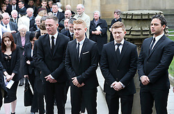 © Licensed to London News Pictures . 18/03/2016 . Manchester , UK . L to R Antony Cotton, Mikey North, Sam Aston and Ryan Thomas watch as the coffin leaves the service. Television stars and members of the public attend the funeral of Coronation Street creator Tony Warren at Manchester Cathedral . Photo credit : Joel Goodman/LNP