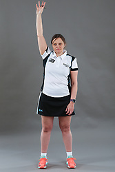 Umpire Rachael Radford signalling goal scored