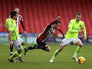 David Buchanan of Northampton fouls Stefan Scougall of Sheffield Utd during the English League One match at Bramall Lane Stadium, Sheffield. Picture date: December 31st, 2016. Pic Simon Bellis/Sportimage
