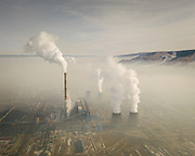 Air pollution in downtwon Ulan Bator near one of the coal-fired power plant located on the edge of the city. Burning fossil fuels is the primary source of both climate-warming emissions and health-damaging air pollution.