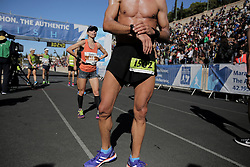 November 13, 2016 - Athens, Attica, Greece - Exhausted runners having just crossed the finish line of the 34th Athens Classic Marathon, at the Panathenaic stadium in Athens, Greece, on Sunday November 13, 2016. (Credit Image: © Panayiotis Tzamaros/NurPhoto via ZUMA Press)