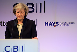 3© Licensed to London News Pictures. 21/11/2016. London, UK. A butterfly lands on stage during a speech by British prime minister THERESA MAY at the Confederation of British Industry (CBI) conference, held at Grosvenor House in London.  Photo credit: Ben Cawthra/LNP