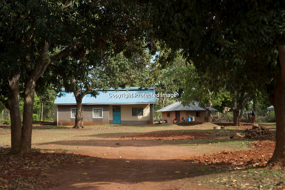 The home of President Obama's grandmother, Mama Sarah, in Kogelo, Nyanza Provice, western Kenya. His father, Barack Hussein Obama, is buried in the compound. The house now has a security fence, electricity, running water, and a Kenyan police detail at the gate. The home of President Obama's grandmother, Mama Sarah, in Kogelo, Nyanza Provice, western Kenya. His father, Barack Hussein Obama, is buried in the compound. The house now has a security fence, electricity, running water, and a Kenyan police detail at the gate.
